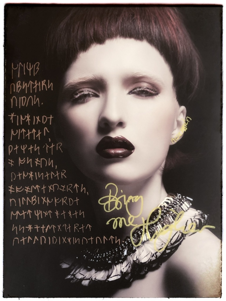 Image with handwritten runic script overlay. Page from Tokyo Fashion Edge Volume 35, 2019.