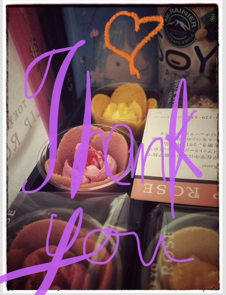 Box of rose shaped cookies (cookie petals with semi-solid cream filling) from Tulip Rose, Tokyo. Thank you scribbled over the top.